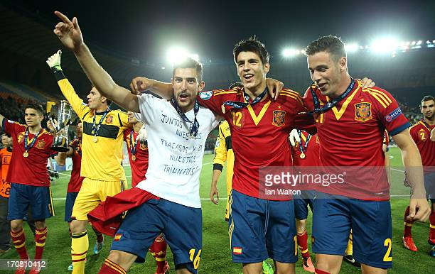 Alvaro Gonzalez Alvaro Morata and Alvaro Vazquez of Spain celebrate after winning the UEFA European U21 Championships Final match between Spain and...