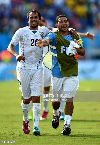 Alvaro Gonzalez and Walter Gargano of Uruguay celebrate the 10 win after the 2014 FIFA World Cup Brazil Group D match between Italy and Uruguay at...