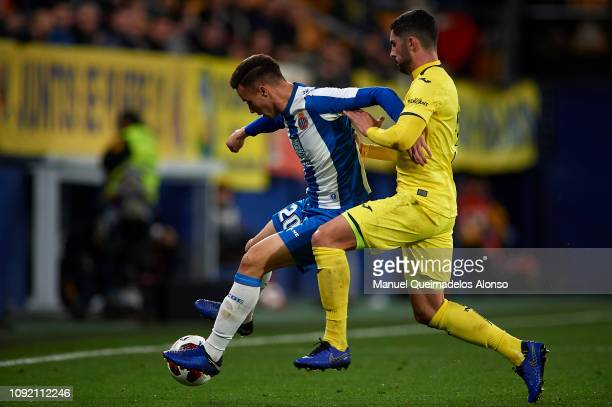 Alvaro Gonzalez of Villarreal CF competes for the ball with Javier Puado of RCD Espanyol during the Copa del Rey Round of 16 first leg match between...