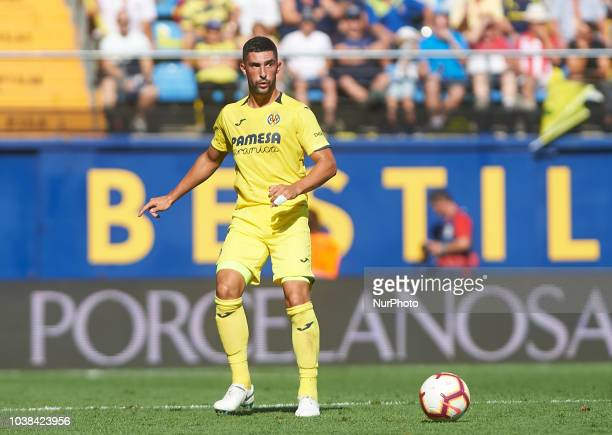 Cristiano Piccini of Valencia CF competes for the ball with Toko Ekambi of Villarreal CF during the La Liga match between Villarreal CF and Valencia...