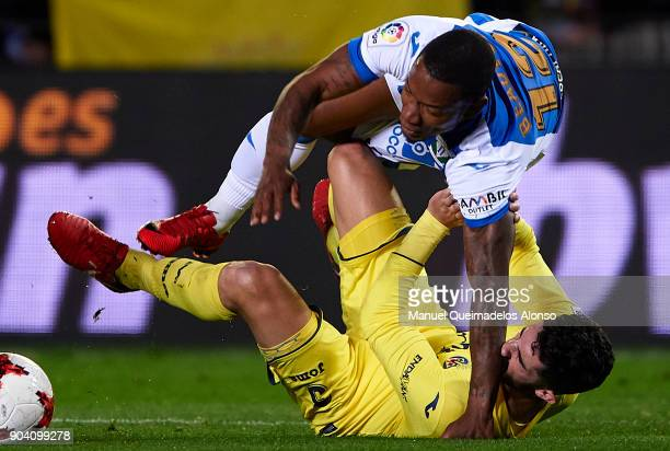 Alvaro Gonzalez of Villarreal competes for the ball with Claudio Beauvue of Leganes during the Copa del Rey Round of 16 second Leg match between...