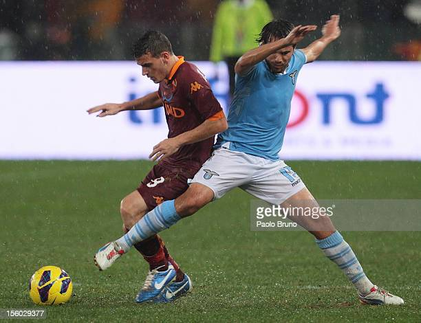 Alvaro Gonzalez SS Lazio competes for the ball with Alessandro Florenzi of AS Roma during the Serie A match between SS Lazio and AS Roma at Stadio...