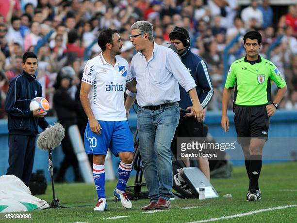 Alvaro Gutierrez coach of Nacional congratulates Alvaro Recoba during a match between Cerro and Nacional as part of round 13 of Campeonato Apertura...