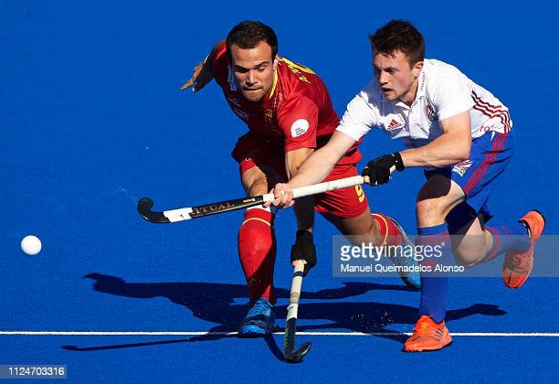 Alvaro Iglesias of Spain competes for the ball with Zachary Wallace of Great Britain during the Men's FIH Field Hockey Pro League match between Spain...