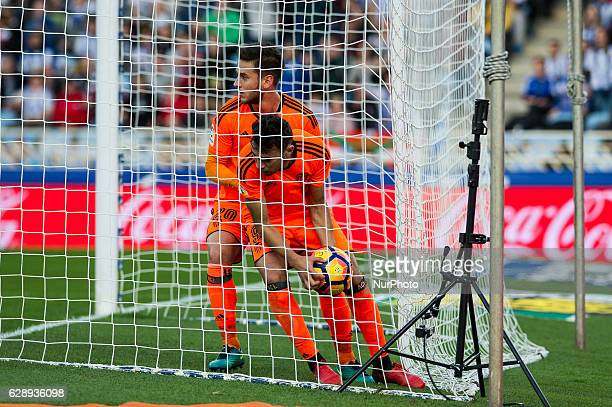 Alvaro Medran and Aymen Abdennour of Valencia during the Spanish league football match between Real Sociedad and Valencia at the Anoeta Stadium in...
