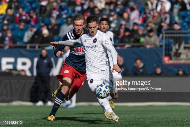 Alvaro Medran of Chicago Fire clears the ball as Adam Buksa of New England Revolution closes during a game between Chicago Fire and New England...