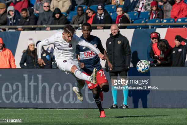 Alvaro Medran of Chicago Fire passes the ball as Cristian Penilla of New England Revolution closes during a game between Chicago Fire and New England...