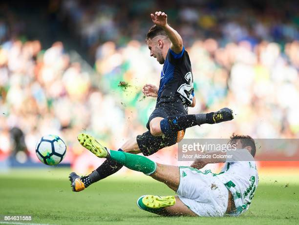 Alvaro Medran of Deportivo Alaves being fouled by Antonio Barragan of Real Betis Balompie during the La Liga match between Real Betis and Alaves at...