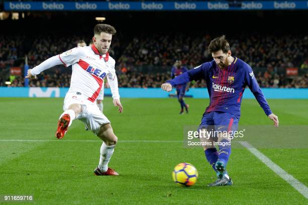 Alvaro Medran of Deportivo Alaves Lionel Messi of FC Barcelona during the La Liga Santander match between FC Barcelona v Deportivo Alaves at the Camp...