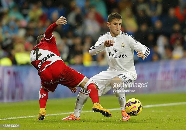 Alvaro Medran of Real Madrid competes for the ball with Tito Roman of Rayo Vallecano during the La Liga match between Real Madrid and Rayo Vallecano...