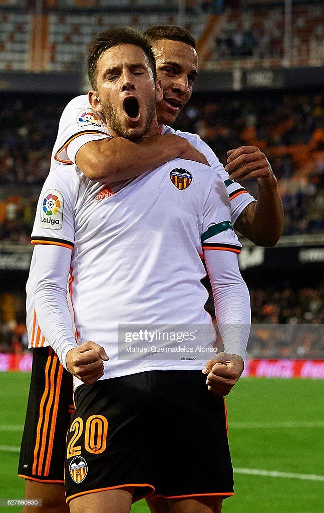 Alvaro Medran of Valencia celebrates scoring his team's second goal with his teammate Rodrigo Moreno (R) during the La Liga match between Valencia CF and Malaga CF at Mestalla Stadium on December 04, 2016 in Valencia, Spain.