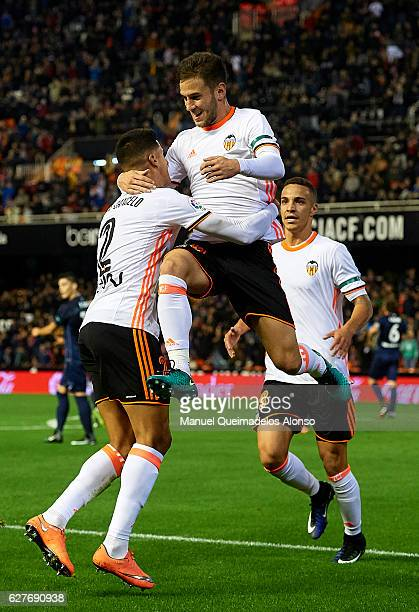 Alvaro Medran of Valencia celebrates scoring his team's second goal with his teammates Joao Cancelo and Rodrigo Moreno during the La Liga match...