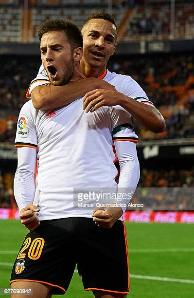 Alvaro Medran of Valencia celebrates scoring his team's second goal with his teammate Rodrigo Moreno during the La Liga match between Valencia CF and...