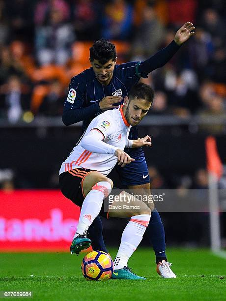 Alvaro Medran of Valencia CF competes for the ball with Chory Castro of Malaga CF during the La Liga match between Valencia CF and Malaga CF at...