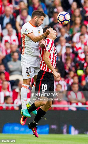 Alvaro Medran of Valencia CF competes for the ball with Oscar De Marcos of Athletic Club during the La Liga match between Athletic Club Bilbao and...