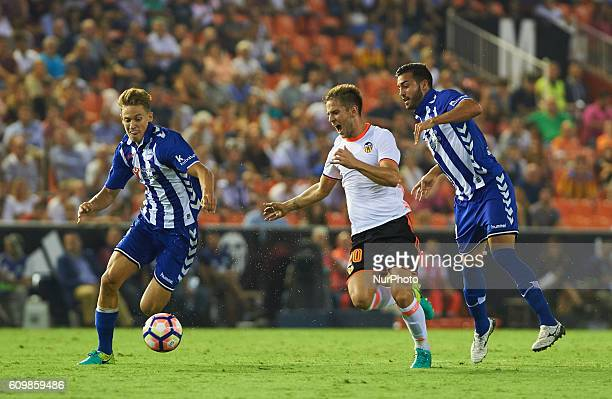 Alvaro Medran of Valencia CF vies Marcos Llorente of Deportivo Alaves during the La Liga match between Valencia CF vs Deportivo Alaves at Mestalla...
