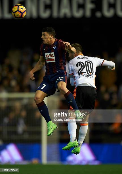 Alvaro Medran of Valencia competes for the ball with Ander Capa of Eibar during the La Liga match between Valencia CF and SD Eibar at Mestalla...