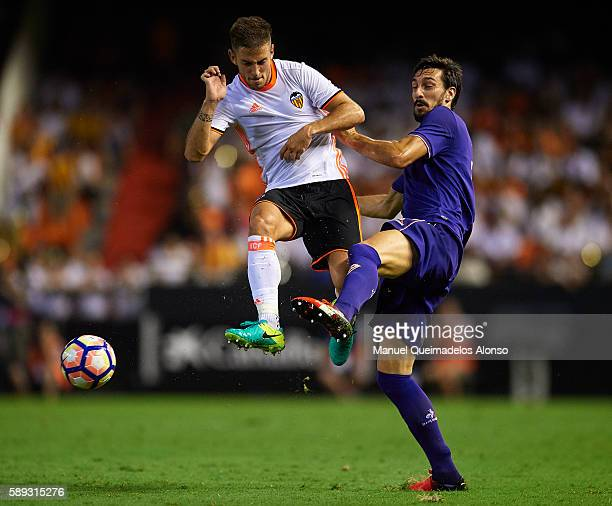 Alvaro Medran of Valencia competes for the ball with Davide Astori of Fiorentina during the preseason friendly match between Valencia CF and AC...