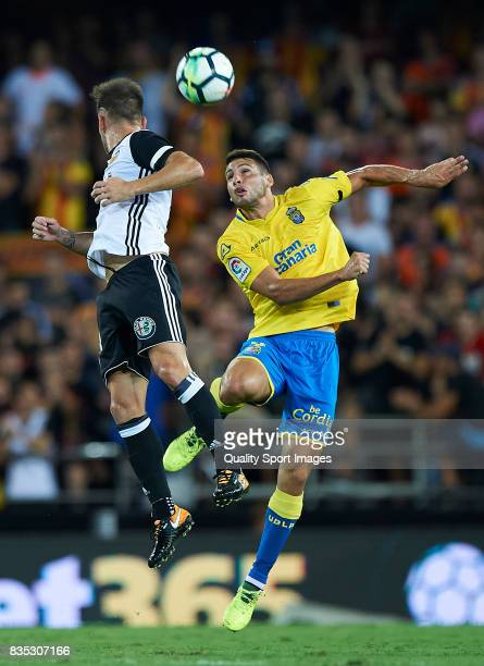 Alvaro Medran of Valencia competes for the ball with Jonathan Calleri of Las Palmas during the La Liga match between Valencia and Las Palmas at...