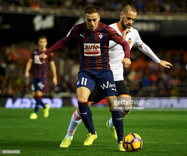 Alvaro Medran of Valencia competes for the ball with Ruben Pena of Eibar during the La Liga match between Valencia CF and SD Eibar at Mestalla...