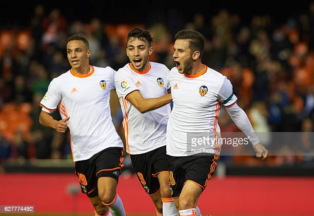 Alvaro Medran Rodrigo Moreno and Munir El Haddadi of Valencia CF celebrates their goal during the La Liga match between Valencia CF vs Malaga CF at...