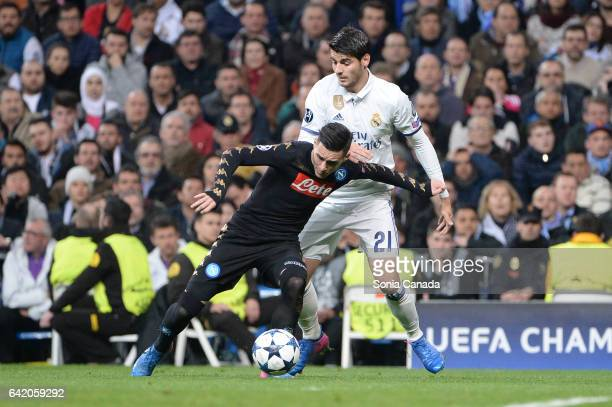 Alvaro Morata #21 of Real Madrid and Jose Callejon #7 of SSC Napoli during the UEFA Champions League Round of 16 first leg match between Real Madrid...