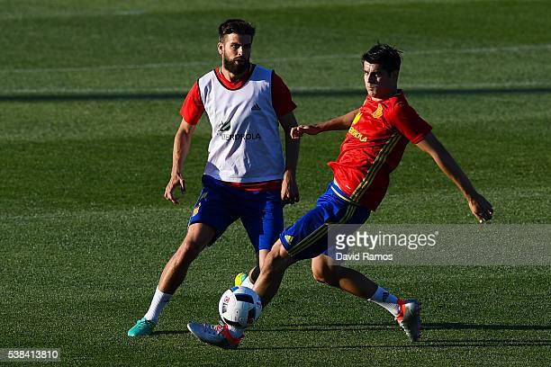 Alvaro Morata and Gerard Pique of Spain in action during a training session at La Ciudad del Futbol de las Rozas on June 6 2016 in Madrid Spain