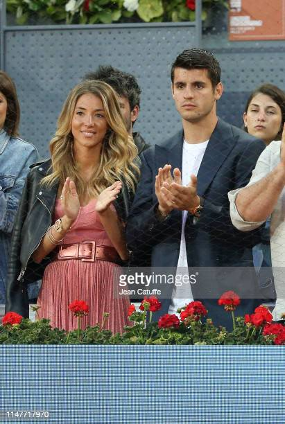Alvaro Morata and his wife Alice Campello applaud the victory of Roger Federer of Switzerland during day 4 of the Mutua Madrid Open at La Caja Magica...
