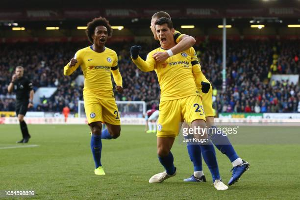 Alvaro Morata celebrates with Ross Barkley and Willian of Chelsea after scoring his teams first goal during the Premier League match between Burnley...