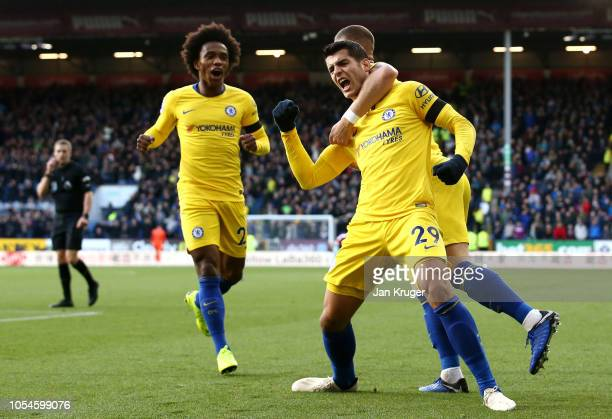 Alvaro Morata celebrates with Ross Barkley and Willian of Chelsea after scoring his team's first goal during the Premier League match between Burnley...