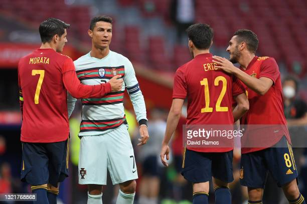 Alvaro Morata, Eric Garcia and Koke of Spain embrace Cristiano Ronaldo of Portugal at the end of the international friendly match between Spain and...