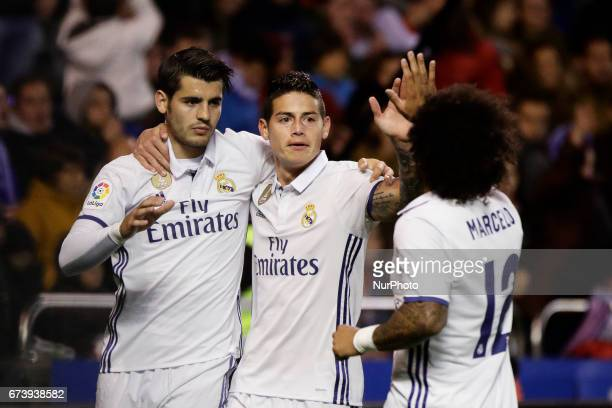 Alvaro Morata forward of Real Madrid James Rodriguez midfielder of Real Madrid and Marcelo Vieira defender of Real Madridd celebrate a goal during...