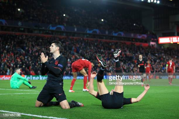 Alvaro Morata of Atletico celebrates after scoring their 3rd goal as teammate Marcos Llorente of Atletico slides in to join him during the UEFA...