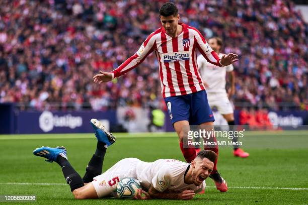 Alvaro Morata of Atletico de Madrid and Lucas Ocampos of Sevilla during the Liga match between Club Atletico de Madrid and Sevilla FC at Wanda...