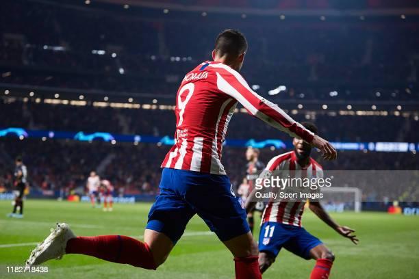 Alvaro Morata of Atletico de Madrid celebrates scoring his team's opening goal during the UEFA Champions League group D match between Atletico de...