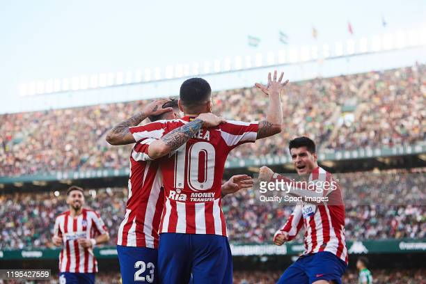 Alvaro Morata of Atletico de Madrid celebrates scoring his team's second goal with team mates during the Liga match between Real Betis Balompie and...