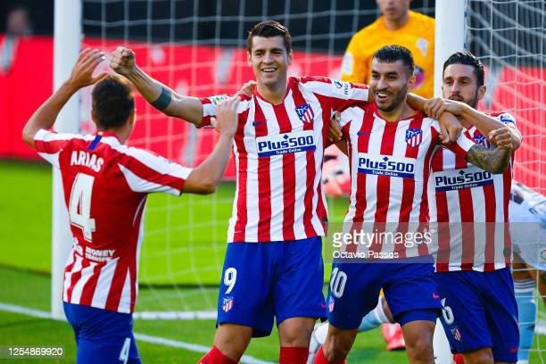 Alvaro Morata of Atletico de Madrid celebrates with his team mates after scoring his team's first goal during the Liga match between RC Celta de Vigo...