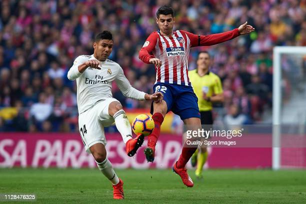 Alvaro Morata of Atletico de Madrid competes for the ball with Casemiro of Real Madrid during the La Liga match between Club Atletico de Madrid and...