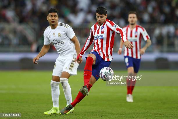 Alvaro Morata of Atletico Madrid battles for possession with Casemiro of Real Madrid during the Supercopa de Espana Final match between Real Madrid...