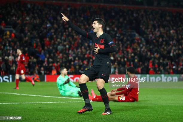 Alvaro Morata of Atletico Madrid celebrates after scoring his team's third goal as Adrian and Joe Gomez of Liverpool react during the UEFA Champions...