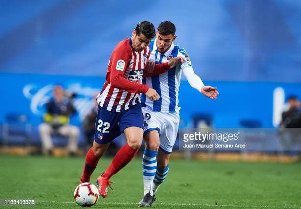 Alvaro Morata of Atletico Madrid duels for the ball with Theo Hernandez of Real Sociedad during the La Liga match between Real Sociedad and Club...