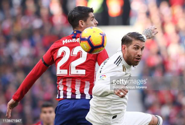 Alvaro Morata of Atletico Madrid jumps with Sergio Ramos of Real Madrid during the La Liga match between Club Atletico de Madrid and Real Madrid CF...