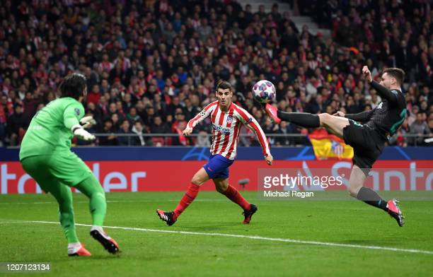 Alvaro Morata of Atletico Madrid looks on as Andy Robertson of Liverpool clears the ball during the UEFA Champions League round of 16 first leg match...