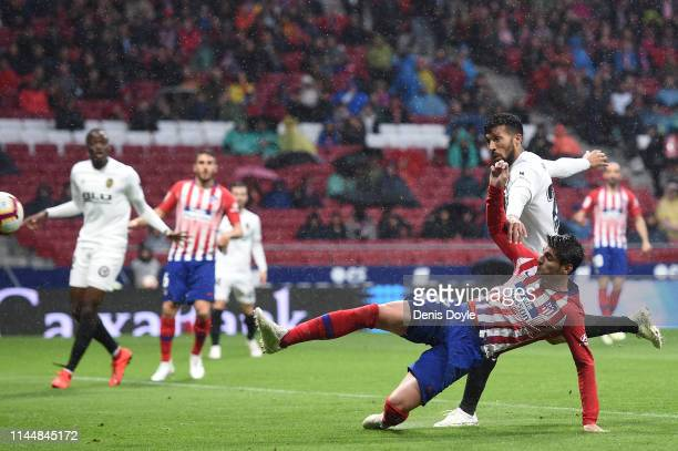 Alvaro Morata of Atletico Madrid scores his team's first goal during the La Liga match between Club Atletico de Madrid and Valencia CF at Wanda...