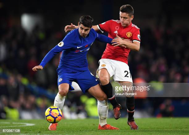 Alvaro Morata of Chelsea and Ander Herrera of Manchester United battle for possession during the Premier League match between Chelsea and Manchester...
