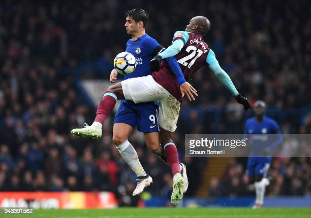 Alvaro Morata of Chelsea and Angelo Ogbonna of West Ham United clashes during the Premier League match between Chelsea and West Ham United at...