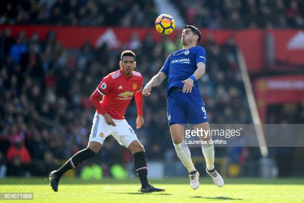 Alvaro Morata of Chelsea and Chris Smalling of Manchester United in action during the Premier League match between Manchester United and Chelsea at...