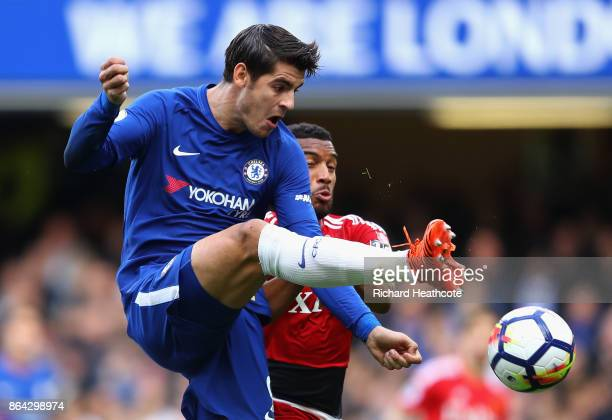 Alvaro Morata of Chelsea and Etienne Capoue of Watford during the Premier League match between Chelsea and Watford at Stamford Bridge on October 21...