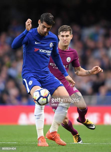 Alvaro Morata of Chelsea and John Stones of Manchester City battle for possession during the Premier League match between Chelsea and Manchester City...