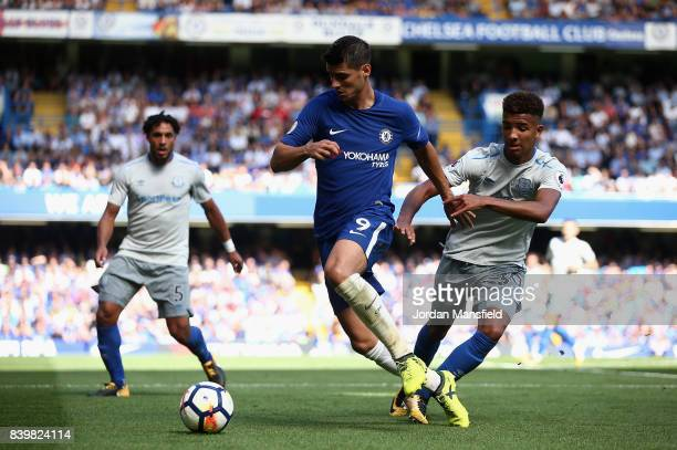 Alvaro Morata of Chelsea and Mason Holgate of Everton battle for possession during the Premier League match between Chelsea and Everton at Stamford...